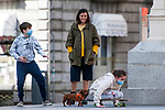 A woman plays with her children and her dog on a street in the center of Madrid during the health crisis due to the Covid-19 virus pandemic - Coronaviruss. April 29, 2020. (ALTERPHOTOS/Ricardo Blanco)