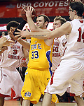 VERMILLION, SD - FEBRUARY 9: Griffan Callahan #33 from South Dakota Statepasses out of a triple team of Steve Tecker #3, Trevor Gruis #50 and Ricardo Andreotti #14 from the University of South Dakota in the first half of their game Thursday night at the DaktaDome in Vermillion, SD. (Photo by Dave Eggen/Inertia)