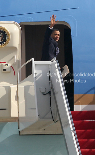 United States President Barack Obama boards Air Force One (AF1)at Andrews AFB in Maryland on Thursday, February 18, 2010 to travel to Denver and Las Vegas.  .Credit: Gary Fabiano / Pool via CNP