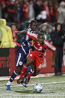 Toronto FC defender Marvell Wynne (16) and New York Red Bulls forward Jozy Altidore (17) battle for the ball. Toronto FC and the New York Red Bulls played to a 1-1 tie during a Major League Soccer match at BMO Field in Toronto, Ontario, Canada, on May 1, 2008.