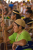 "Altamira, Brazil. ""Xingu Vivo Para Sempre"" protest meeting about the proposed Belo Monte hydroeletric dam and other dams on the Xingu river and its tributaries. Parakanan Indian with bow and arrows."