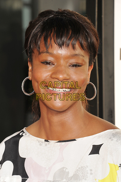 Sufe Bradshaw.'True Blood' Season 5 Los Angeles Premiere at ArcLight Cinemas Cinerama Dome, Hollywood, California, USA..May 30th, 2012.headshot portrait white black silver hoop earrings .CAP/ROT/TM.© TM/Roth/Capital Pictures