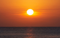 Belize, Central America - Centered sunset over calm ocean