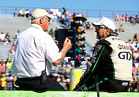 Sept. 21, 2013; Ennis, TX, USA: NHRA funny car driver John Force (right) talks with NHRA official Graham Light during the Fall Nationals at the Texas Motorplex. Mandatory Credit: Mark J. Rebilas-