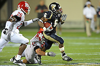 11 September 2010:  FIU running back Jeremiah Harden (6) breaks away from Rutgers defensive end Alex Silvestro (45) with Rutgers cornerback Joe Lefeged (26) in pursuit in the second quarter as the Rutgers Scarlet Knights defeated the FIU Golden Panthers, 19-14, at FIU Stadium in Miami, Florida.