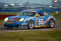 The #66 Porsche 996 of Michael Schrom, Jörg Bergmeister, Timo Bernhard, and Kevin Buckler races to a 7th place finsih at the 24 Hours of Daytona, Daytona International Speedway, Daytona Beach, FL, February 3, 2002.  (Photo by Brian Cleary/www.bcpix.com)