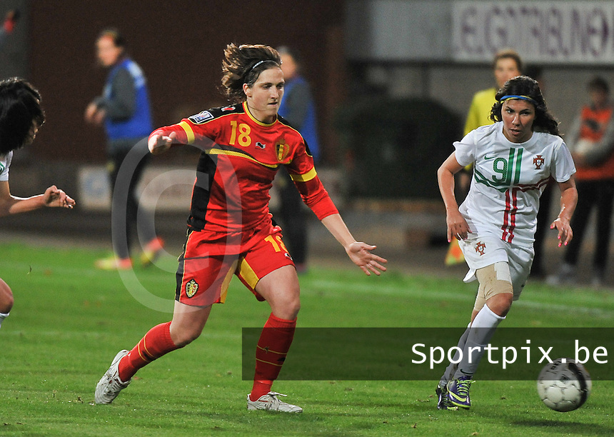 20131031 - ANTWERPEN , BELGIUM : Belgian Maud Coutereels (18) pictured with Portugese Ana Borges (9) during the female soccer match between Belgium and Portugal , on the fourth matchday in group 5 of the UEFA qualifying round to the FIFA Women World Cup in Canada 2015 at Het Kiel stadium , Antwerp . Thursday 31st October 2013. PHOTO DAVID CATRY