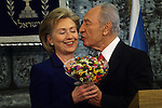 Israeli President Shimon Peres (R) kisses US Secretary of State, Hillary Clinton (L) during their meeting at Peres' residency in Jerusalem, Tuesday, March 3, 2009. Clinton declared that the U.S. will work closely with any new Israeli government, and emphasized the necessity of a two-state solution to the Israeli-Palestinian conflict. Upon the conclusion of the meeting, which was also attended by Middle East envoy George Mitchell, Peres and Clinton spoke with the press. Throughout the day, Clinton is set to meet with Prime Minister-designate Binyamin Netanyahu, Prime Minister Ehud Olmert, Foreign Minister Tzipi Livni and Defense Minister Ehud Barak. Photo By: Tess Scheflan / JINI.