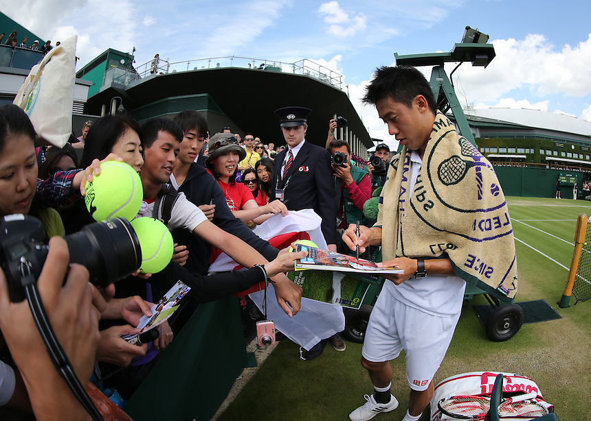 Kei Nishikori (JPN) [10] celebrates his Victory against Simone Bolelli (ITA) in their Gentlemen's Singles Third Round match today<br /> <br /> Photographer Kieran Galvin/CameraSport<br /> <br /> Tennis - Wimbledon Lawn Tennis Championships - Day 7 Monday 30th June 2014 -  All England Lawn Tennis and Croquet Club - Wimbledon - London - England<br /> <br /> &copy; CameraSport - 43 Linden Ave. Countesthorpe. Leicester. England. LE8 5PG - Tel: +44 (0) 116 277 4147 - admin@camerasport.com - www.camerasport.com.