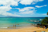 "People enjoying the clear blue water at """"Baby or Little Beach"""" at Makena on West Maui."