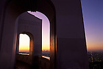 Sunrise over LA through archways at the Griffith Park Observatory, Downtown District with skyscrapers, Los Angeles California USA