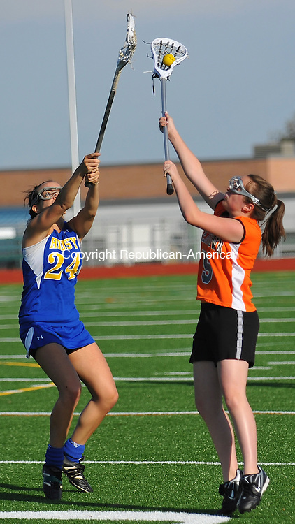 WATERTOWN, CT-22 APRIL 2010-042210IP11- Housatonic's Bianca Ianucci and Watertown's Carrie Faber fight for the ball during their lacrosse game at Watertown High School on Thursday. Housatonic won 10 to 5. <br /> Irena Pastorello Republican-American
