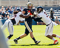 Pitt tight end JP Holtz makes a catch. The Pitt Panthers football team defeated the Virginia Cavaliers 26-19 on Saturday October 10, 2015 at Heinz Field, Pittsburgh, Pennsylvania.