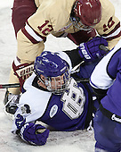 Kevin Hayes (BC - 12), Ryan McGrath (HC - 23) - The visiting College of the Holy Cross Crusaders defeated the Boston College Eagles 5-4 on Friday, November 29, 2013, at Kelley Rink in Conte Forum in Chestnut Hill, Massachusetts.