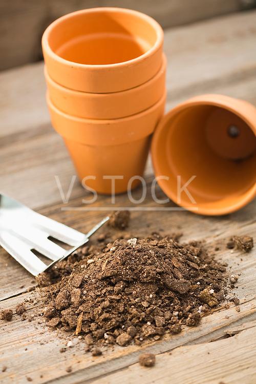 Dirt next to flowering pots