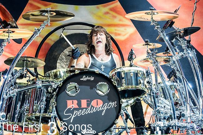 Bryan Hitt of REO Speedwagon performs at Riverbend Music Center in Cincinnati, Ohio.