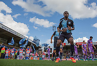 Marcus Bean of Wycombe Wanderers heads out onto the field followed by teammates during the Sky Bet League 2 match between Wycombe Wanderers and Plymouth Argyle at Adams Park, High Wycombe, England on 12 September 2015. Photo by Andy Rowland.