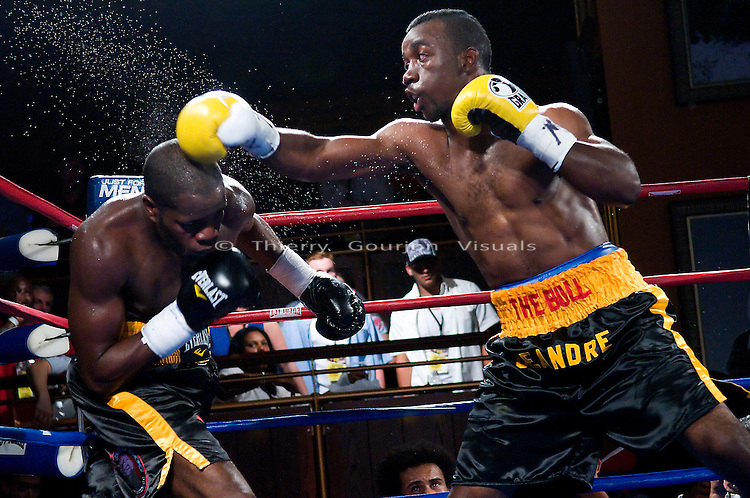 New York, NY - 06.11.2008: Deandre Latimore (yellow gloves) on the attack against Sechew Powell during their 10 rounds Jr. Middleweight fight at the Hard Rock Cafe in Times Square. Latimore upset Powell with a 7th round tko.
