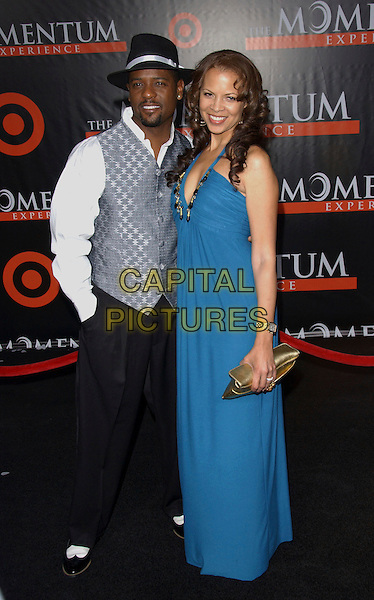 "BLAIR UNDERWOOD & WIFE.""The Seat Filler"" Premiere held at El Capitan Theatre  in Hollywood, California, USA.  .February 22, 2006.Ref: DVS.full length married husband black hat grey gray dress vest black .www.capitalpictures.com.sales@capitalpictures.com.Supplied By Capital PIctures"