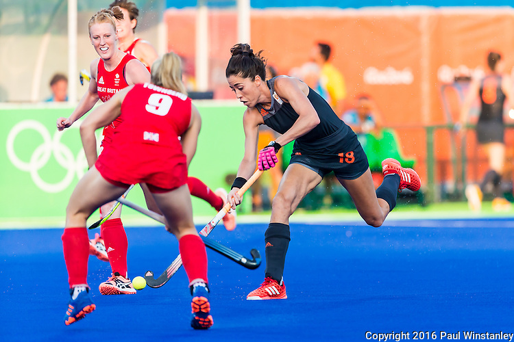 Naomi van As #18 of Netherlands passes the ball during Netherlands vs Great Britain in the gold medal final at the Rio 2016 Olympics at the Olympic Hockey Centre in Rio de Janeiro, Brazil.