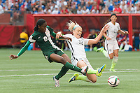 June 16, 2015: Asisat OSHOALA of Nigeria kicks for goal during a Group D match at the FIFA Women's World Cup Canada 2015 between Nigeria and the USA at BC Place Stadium on 16 June 2015 in Vancouver, Canada. USA won 1-0. Sydney Low/Asteriskimages.com
