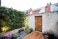 A Victorian home has been given a modernist aesthetic. The small back garden is low maintenance.