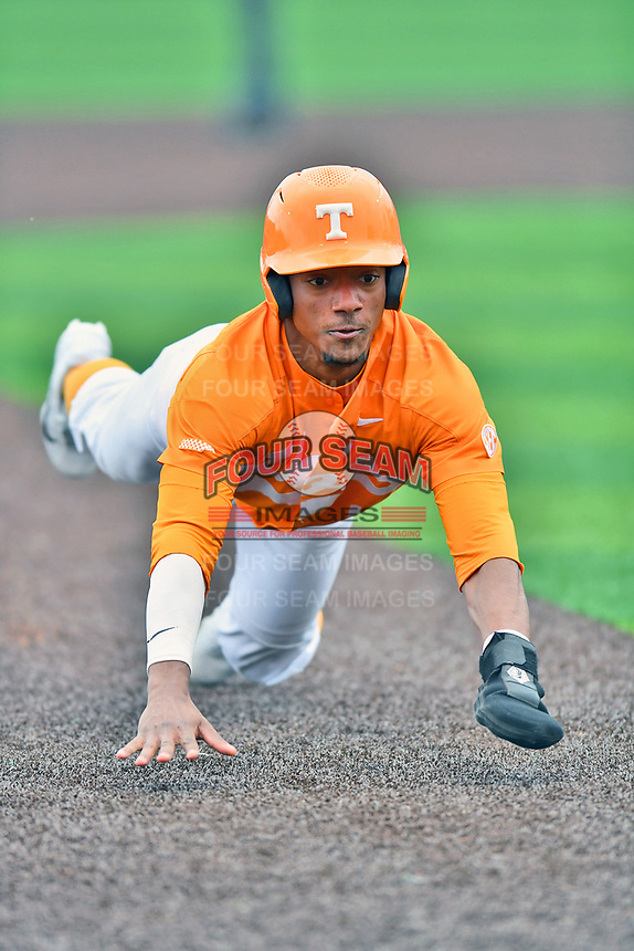 Tennessee Volunteers center fielder Jay Charleston (4) slides into third base during a game against the Appalachian State Mountaineers at Lindsey Nelson Stadium on February 16, 2019 in Knoxville, Tennessee. The Volunteers defeated Mountaineers 2-0. (Tony Farlow/Four Seam Images)