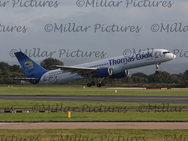 A Thomas Cook Airlines Boeing 757-28A Registration G-FCLE bound for Kittila Airport, Finland taking off at Manchester Airport on 17.10.13.