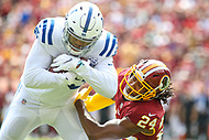 Landover, MD - September 16, 2018: Washington Redskins defensive back Josh Norman (24) tackles Indianapolis Colts tight end Eric Ebron (85) during the  game between Indianapolis Colts and Washington Redskins at FedEx Field in Landover, MD.   (Photo by Elliott Brown/Media Images International)