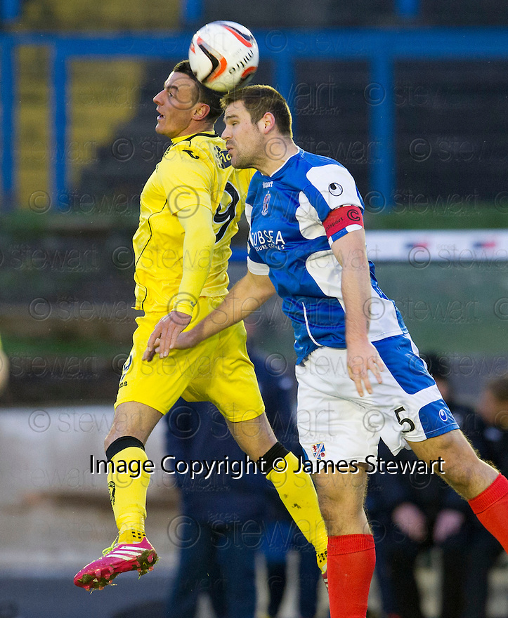 Queen of the South's Derek Lyle and Cowdenbeath's John Armstrong challenge for the ball.