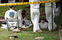 Forensic technicians exhume bodies of people who went missing during Colombia's armed conflict in Co