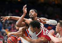 NWA Democrat-Gazette/CHARLIE KAIJO Arkansas Razorbacks forward Gabe Osabuohien (22) reaches for a loose ball with Florida Gators defenders during the Southeastern Conference Men's Basketball Tournament quarterfinals, Friday, March 9, 2018 at Scottrade Center in St. Louis, Mo.