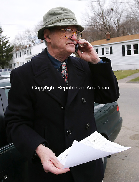 WATERBURY, CT 4/10/07- 041007BZ05- Dennis Brown, land use officer for the City of Waterbury, tries to call a complainant while checking for illegal chickens on Proctor Street in Waterbury Tuesday.  Under Waterbury's zoning, only those in possession of at least an acre of land can have a chicken.<br /> Jamison C. Bazinet Republican-American