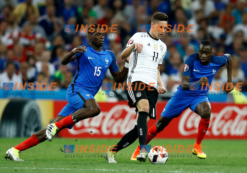 Julian Draxler (Germany) in action between Paul Pogba and Patrice Evra (France)<br /> Marseille 07-07-2016 Stade Velodrome Football Euro2016 Germany - France / Germania - Francia Semi-finals / Semifinali <br /> Foto Matteo Ciambelli / Insidefoto