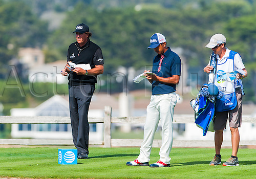 14.02.2016. Carmel, California, USA.  Phil Mickelson and  Hiroshi Iwata of Japan  are both battling it out for the top spot  during the final  round of the AT&T Pebble Beach National Pro-Am  in Pebble Beach, CA.