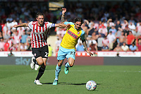 Ryan Williams of Rotherham tries to shake off a challenge from Brentford's Henrik Dalsgaard during Brentford vs Rotherham United, Sky Bet EFL Championship Football at Griffin Park on 4th August 2018