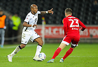 29th November 2019; Liberty Stadium, Swansea, Glamorgan, Wales; English Football League Championship, Swansea City versus Fulham; Andrew Ayew of Swansea City tries to get past Joe Bryan of Fulham  - Strictly Editorial Use Only. No use with unauthorized audio, video, data, fixture lists, club/league logos or 'live' services. Online in-match use limited to 120 images, no video emulation. No use in betting, games or single club/league/player publications