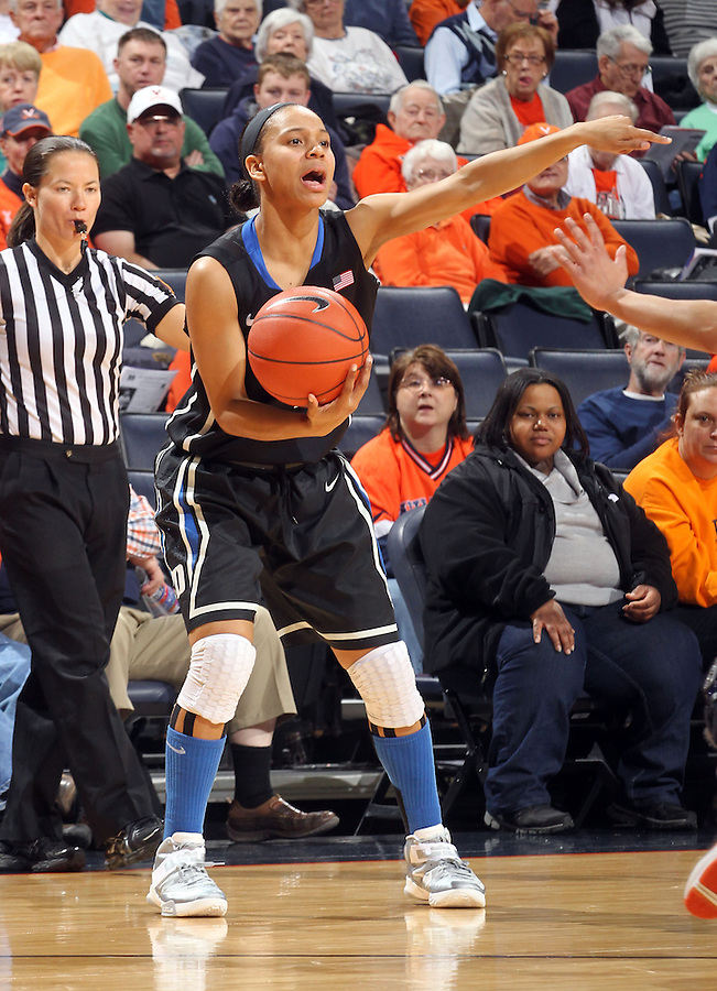 Duke guard Chloe Wells (4) handles the ball during an NCAA college basketball game in Charlottesville, Va. Duke defeated Virginia 62-41...