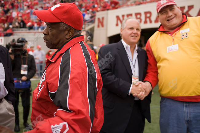 Supreme Court Justice Clarence Thomas (left) and radio personality Rush Limbaugh (center) stand on the sidelines before The University of Nebraska vs. The University of Southern California football game. Lincoln, Nebraska, September 15, 2007.