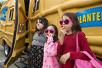 NWA Democrat-Gazette/BEN GOFF @NWABENGOFF<br /> Madison Raper (from left), 9, Sadie Moppin, 10, and Melodie Raper, 8, blow their weenie whistles Friday, May 10, 2019, at the Inclusion Town area at Compton Gardens during the Bentonville Film Festival.