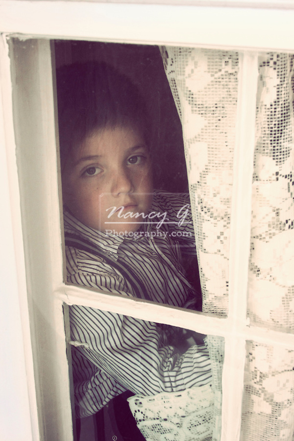 A young boy looking out of a window