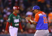 Luis Cruz , pitcher relevo de los Criollos de Caguas de Puerto Rico celebra out en el septimo inning  del juego de béisbol de la Serie del Caribe contra los Tomateros de Culiacan de Mexico en Guadalajara, México,  viernes 2 feb 2018. (Foto AP / Luis Gutierrez)