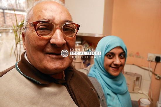 Asian carer with elderly Asian man in the kitchen, ***NOT TO BE USED IN THE EAST MIDLANDS***