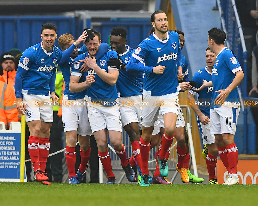 Portsmouth players mob goalscorer Matthew Clarke during Portsmouth vs Accrington Stanley, Sky Bet EFL League 2 Football at Fratton Park on 11th February 2017