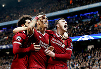 Liverpool's Roberto Firmino (centre) celebrates with team-mates Mohamed Salah (left) and Andrew Robertson after scoring his side's second goal <br /> <br /> Photographer Rich Linley/CameraSport<br /> <br /> UEFA Champions League Quarter-Final Second Leg - Manchester City v Liverpool - Tuesday 10th April 2018 - The Etihad - Manchester<br />  <br /> World Copyright &copy; 2017 CameraSport. All rights reserved. 43 Linden Ave. Countesthorpe. Leicester. England. LE8 5PG - Tel: +44 (0) 116 277 4147 - admin@camerasport.com - www.camerasport.com
