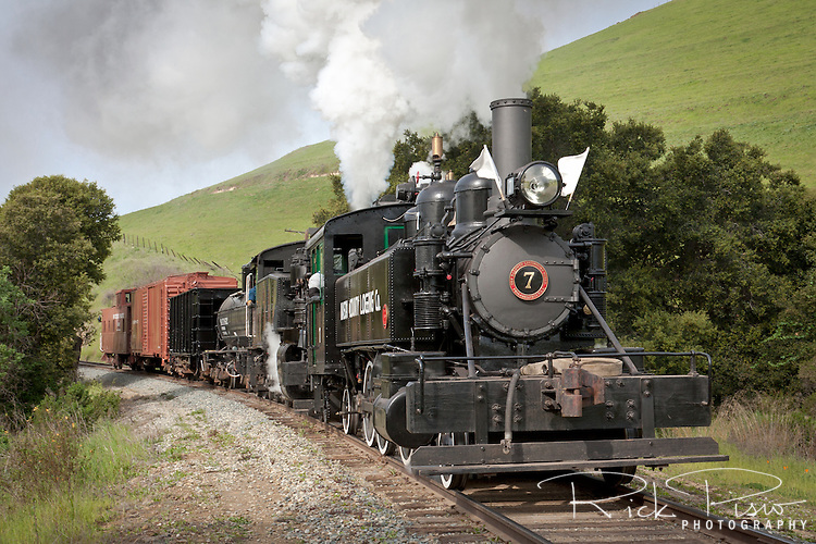 Mason County Logging #7 leads a freight train through Niles Canyon as part of the Niles Canyon Railway Steamfest II. The Mason County Logging Co. #7 was built in 1910 by the Baldwin Locomotive Works.