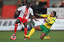 Lucas Akins of Stevenage is tackled by Luke Benbow of Stourbridge<br />  - Stevenage v Stourbridge - FA Cup Round 2 - Lamex Stadium, Stevenage - 7th December, 2013<br />  © Kevin Coleman 2013