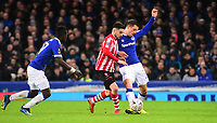 Lincoln City's Tom Pett vies for possession with Everton's Gylfi Sigurosson<br /> <br /> Photographer Andrew Vaughan/CameraSport<br /> <br /> Emirates FA Cup Third Round - Everton v Lincoln City - Saturday 5th January 2019 - Goodison Park - Liverpool<br />  <br /> World Copyright &copy; 2019 CameraSport. All rights reserved. 43 Linden Ave. Countesthorpe. Leicester. England. LE8 5PG - Tel: +44 (0) 116 277 4147 - admin@camerasport.com - www.camerasport.com