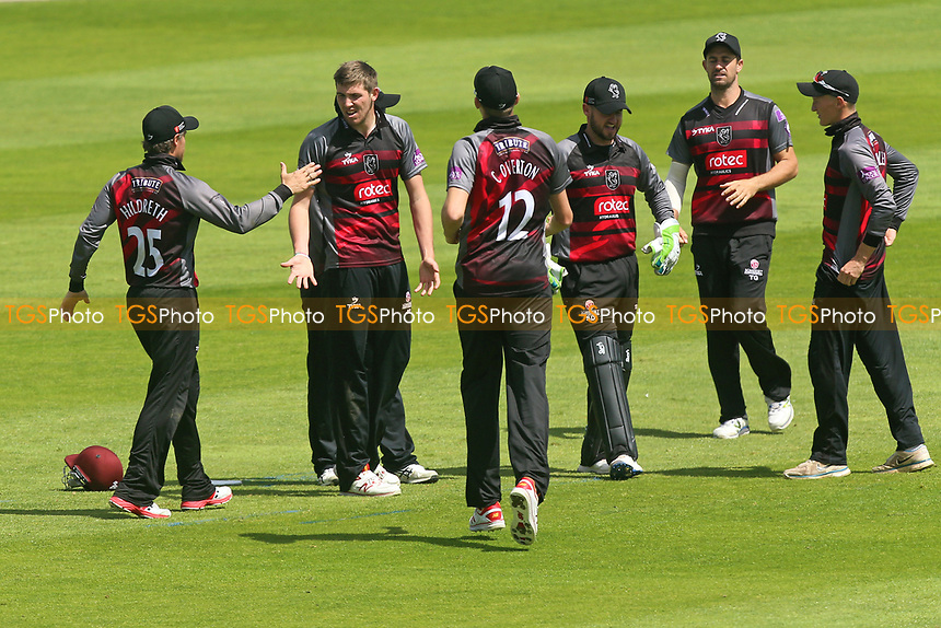 Jamie Overton of Somerset is congratulated by his team mates after taking the wicket of Alastair Cook during Somerset vs Essex Eagles, Royal London One-Day Cup Cricket at The Cooper Associates County Ground on 14th May 2017