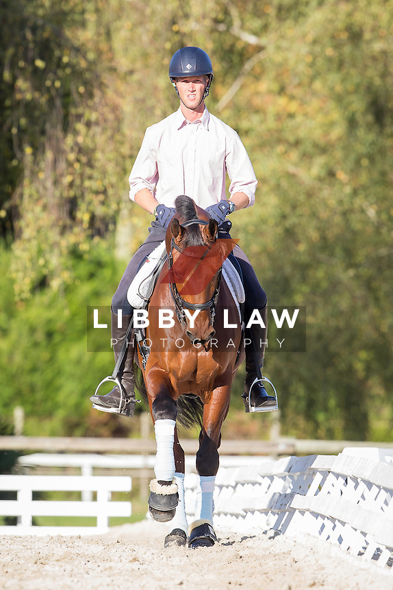 USA-Clark Montgomery (UNIVERSE) do some light schooling - they do their Dressage at 3.20pm tomorrow: 2014 FRA-Les Etoiles de Pau (Thursday 23 October) CREDIT: Libby Law COPYRIGHT: LIBBY LAW PHOTOGRAPHY - NZL